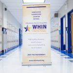 whin-sign-hallway-lockers