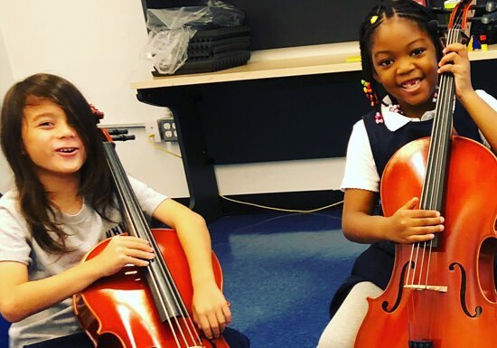 WHIN students composing with stringed instruments